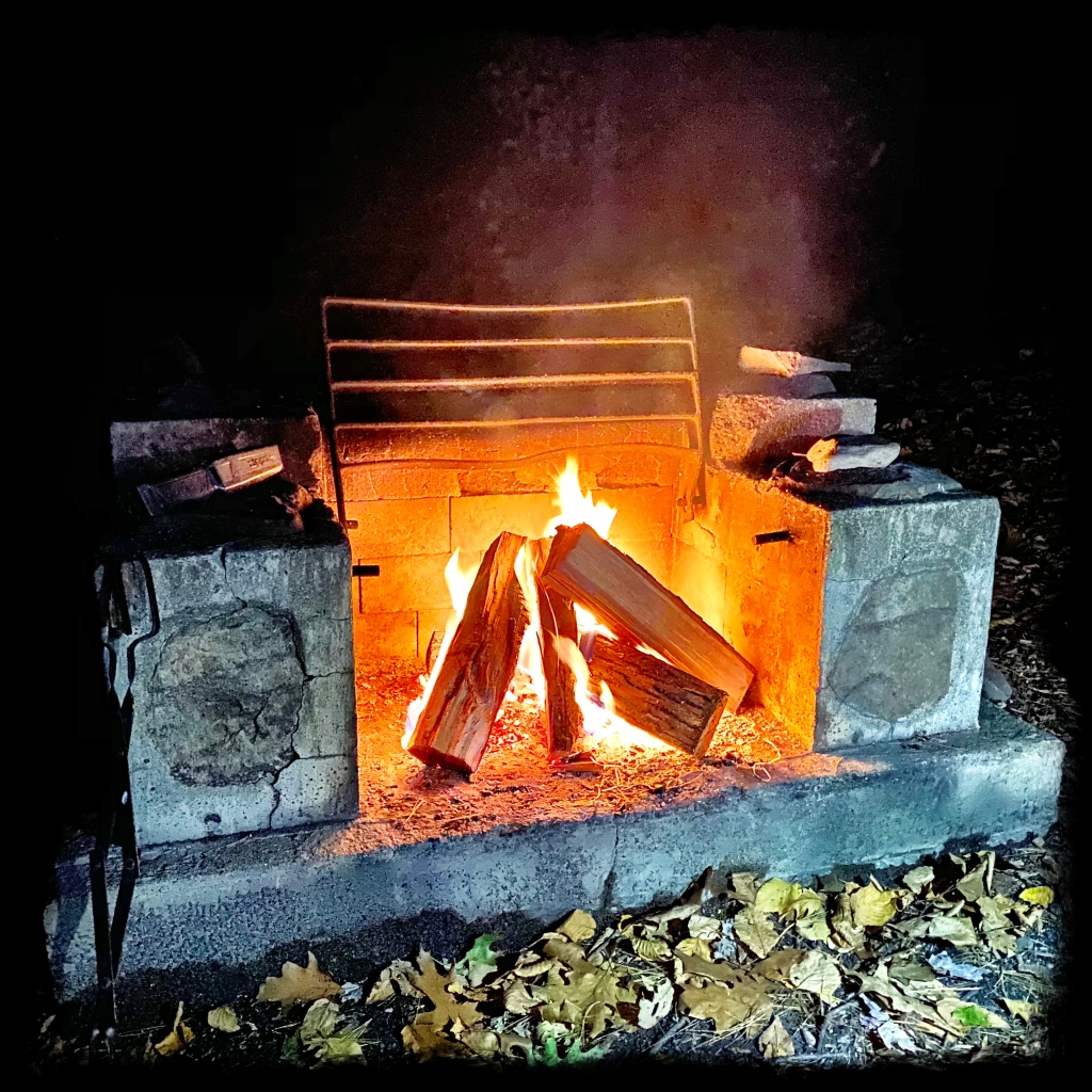 Fire burning in a concrete firepit